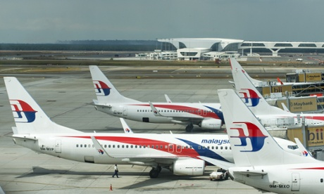 Malaysia Airlines continues service as planes prepare for passengers to board at Kuala Lumpur Airport.
