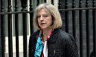 Theresa May walking into Downing Street