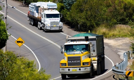 Trucks on the Great Western Highway from Sydney to Adelaide, New South Wales, Australia 2 trucks Vehicles Two trucks Trucking Truck Transporting goods Transportation Transport Trailers Road train Outside Outdoors Moving Movement Motion Lorry Lorries Long-haul Long haul Horizontal HGVs HGV Heavy trucks Heavy Goods Vehicle Haulage Going downhill Front grill Freight transfer Driving Drive Daytime Coloured yellow Colour white Colored yellow Color white Cargo Bull-bars Bull bars Bulk transport Australian road trains Heavy lorries One behind the other Following on Safety barrier Round the bend Continuous white line Danger Risk Road trip Freight carriers Cargo carrier Road transport Highway Journey Travel Heavy load Loaded Laden Lorry cab Truck driver Go the distance Stock image