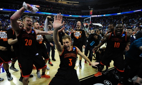 The Mercer Bears celebrate after defeating the Duke Blue Devils to advance to the Round of 32 in the NCAA Men's Division I Men's Basketball Tournament.