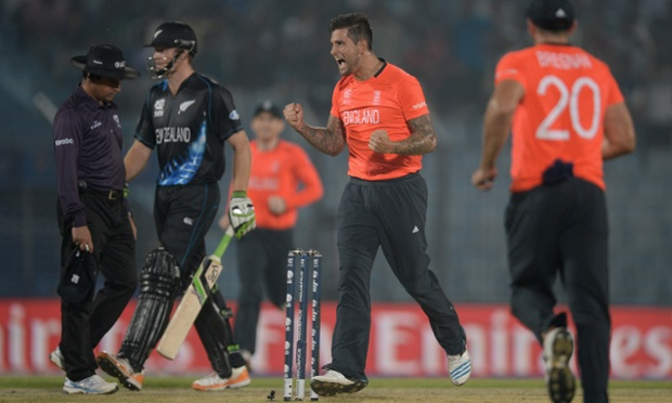 Jade Dernbach of England celebrates dismissing Martin Guptill - England's only wicket before the rain descended.