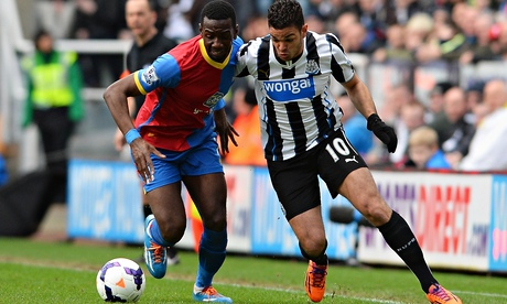 Newcastle's Hatem Ben Arfa takes on Crystal Palace's Yannick Bolasie at St James' Park.