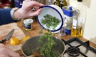 Felicity Cloake makes dal with kale in her kitchen.
