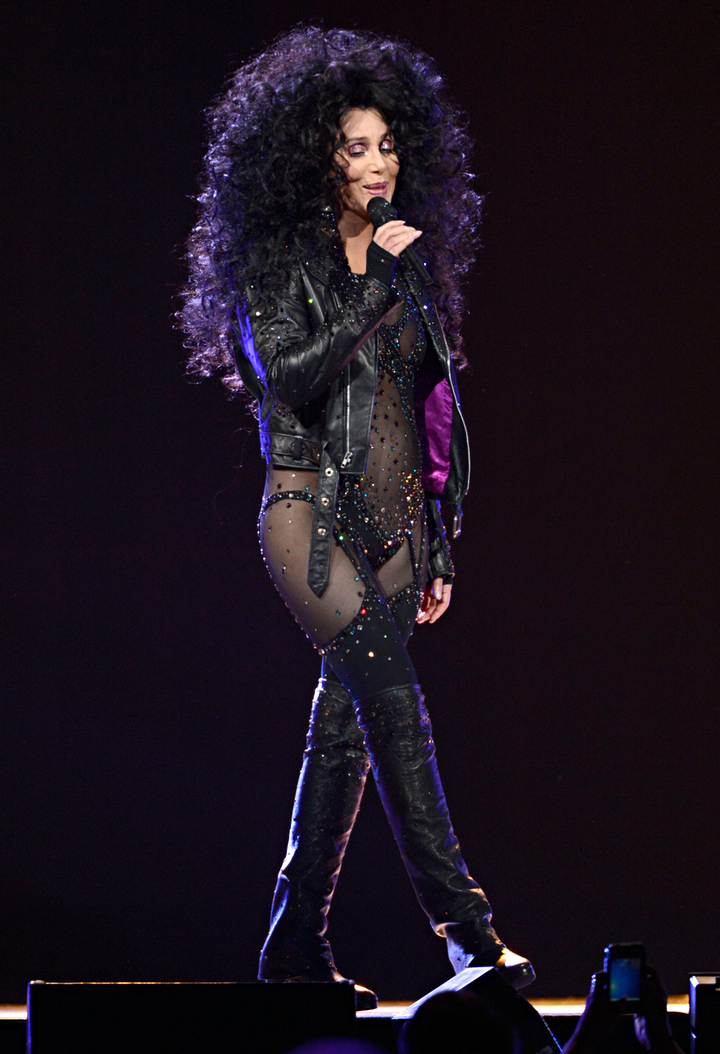 Cher performs on stage during her Dressed To Kill tour opener at the US Airways Centre on 22 March 2014. Photograph: Kevin Mazur/WireImage