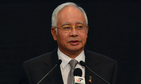Malaysia prime minister Najib Razak speaks during a press conference where he announced that the missing Malaysia Airlines flight MH370