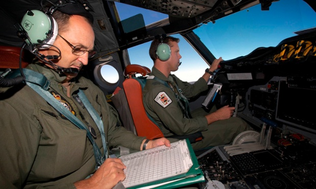 Co-Pilot Flying Officer Marc Smith (R) and a crewman calculate fuel consumption aboard a Royal Australian Air Force (RAAF) AP-3C Orion aircraft search for the missing Malaysian Airlines Flight MH370 over the southern Indian Ocean March 24, 2014.