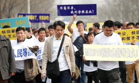 Relatives of flight MH370 passengers march to the Malaysian embassy in Beijing – a rare sight in a country that is strict on public protests. Photograph: Lintao Zhang/Getty Images