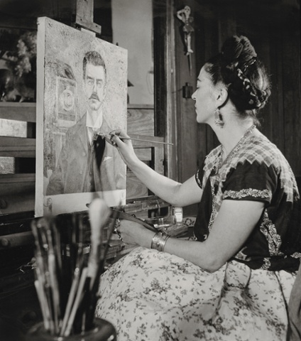 Frida painting the portrait of her father by Gisèle Freund, 1951.