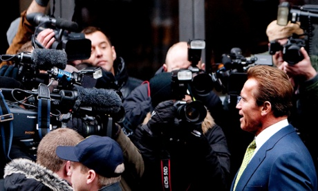 California Governor Arnold Schwarzenegger talks to Danish media as he leaves his hotel in Copenhagen o n December 15, 2009 to go to a press conference at the UN Climate Change Conference at the Bella Center. Photograph: Bax Lindhardt/AFP/Getty Images