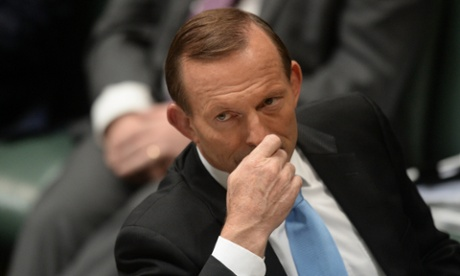Prime Minister Tony Abbott reacts during House of Representatives Question Time at Parliament House in Canberra, Wednesday, March 26, 2014.