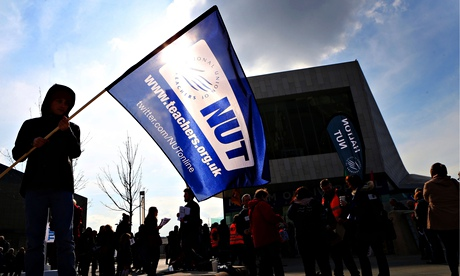 A boy holds a flag in support for the Nation Union of Teachers