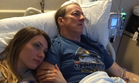This recent photo provided by Jill Kelly shows Jim Kelly in hospital with his daughter, Erin.