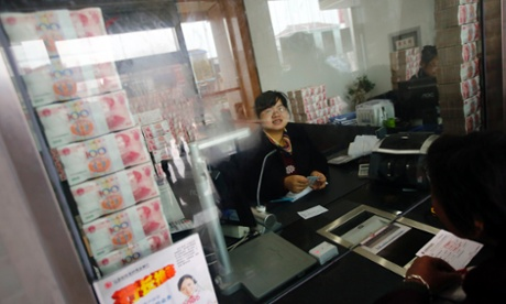 Cash stacked up at Jiangsu Sheyang Rural Commercial Bank in Yancheng, Jiangsu province, to show it has not run out of money.