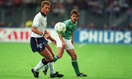 Terry Butcher and Olaf Thon keep their eyes on the ball.