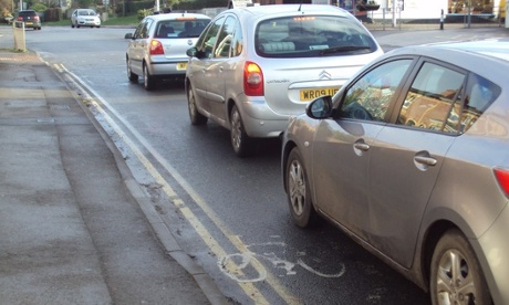 Cars queueing at a junction.
