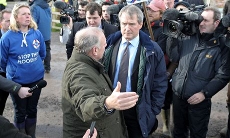 Environment secretary Owen Paterson talks to flooded residents in Somerset before emergency surgery