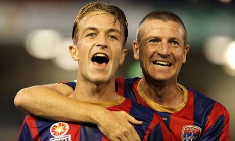 Newcastle Jets teammates Adam Taggart and Michael Bridges celebrate beating Wellington Phoenix 5-0 last weekend.