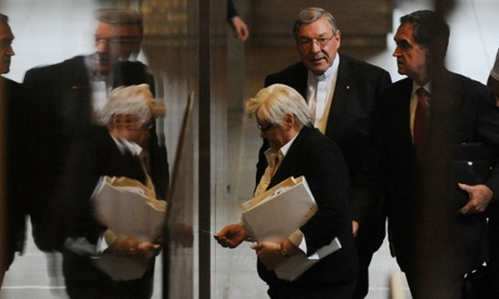 Cardinal George Pell (centre) leaves the royal commission after his final day in the witness box on Thursday