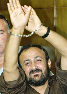 Marwan Barghouti, a prominent leader of the Palestinian uprising, enters court