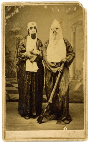 A carte de visite of anonymous men in Ku Klux Klan uniforms, 1868.