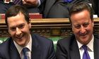 Chancellor of the exchequer George Osborne laughs alongside the PM in the House of Commons