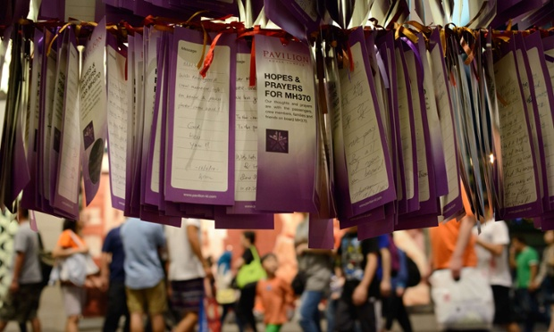 Messages for passengers of missing Malaysian airlines flight MH370 are displayed in Kuala Lumpur on March 28, 2014.