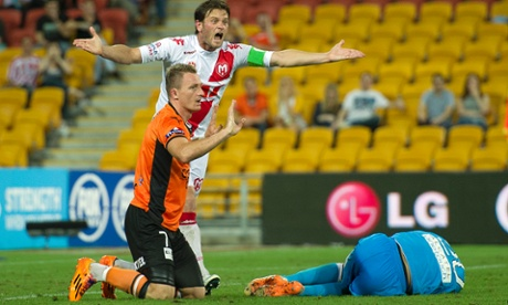 Roar player Besart Berisha (left) and Heart player Robbie Wielart react after Berisha fouled Heart keeper Tando Velaphi (right) during the Round 25 A-League match