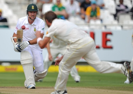 Australia's Ryan Harris, front, prevents South Africa's Graham Smith, from making a run during the third day of the third test in Cape Town.