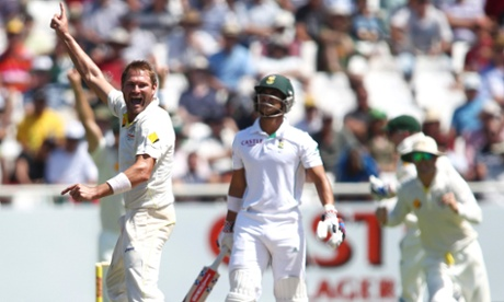 Australia's Ryan Harris celebrates taking the wicket of South Africa's JP Duminy during the third day of the third Test match at Newlands Stadium in Cape Town.