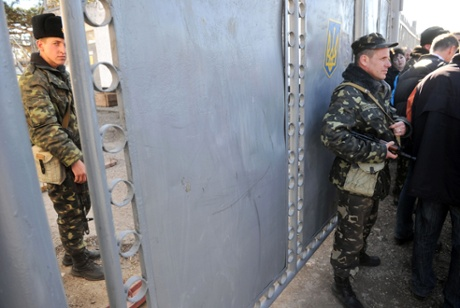 Ukrainian soldiers guard the entrance of a military base in the Crimean city of Bakhchisaray.