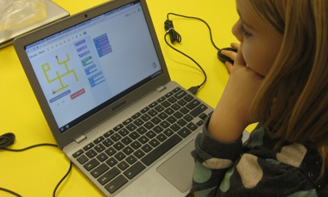 child coding a computer game
