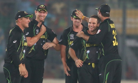 Brad Hodge of Australia is congratulated by his teammates after dismissing Rohit Sharma.
