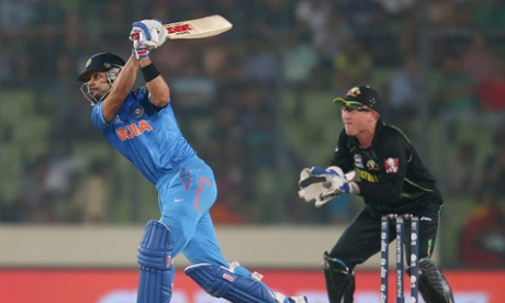 Virat Kohli of India wafts a tame effort towards long on and is caught out.