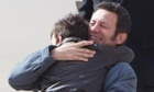 Spanish reporter Javier Espinosa hugs as his son Yerai upon his arrival at the military airport of Torrejon in Madrid, Spain, Sunday, March 30