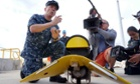 US navy director of ocean engineering captain Mark Matthews introduces equipments to be used for searching the missing Malaysia Airlines Flight MH370 in Perth on Sunday.