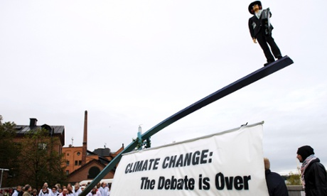 Climate change: the debate is over reads activists banner outside IPCC meeting in Stockholm, Sweden