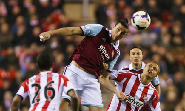 Sunderland's Wes Brown  is beaten to the ball by West Ham's Andy Carroll.