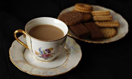 tea time a cup of tea and plate of orange coconut tea orange cookies ...