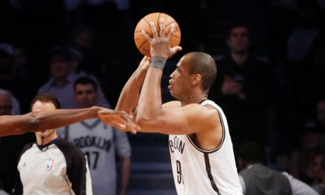 Jason Collins makes his first shot as a Net in Brooklyn against the Chicago Bulls at the Barclays Center on Monday, March 3, 2014.