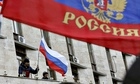 Demonstrators fly the Russian flag after occupying a government building in Donetsk, Ukraine