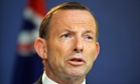 This picture taken on December 16, 2013 shows a Australia Prime Minister Tony Abbott speaks at a press conference in Sydney.  Abbott defended the government's secrecy over its border protection policy on January 9, 2014, after reports that boats had been turned back to Indonesia and asylum-seekers mistreated. AFP PHOTO / Saeed KHANSAEED KHAN/AFP/Getty Images