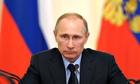 Russia's President Vladimir Putin (C) ch