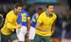 Tim Cahill celebrates the opening goal with Matthew Leckie.