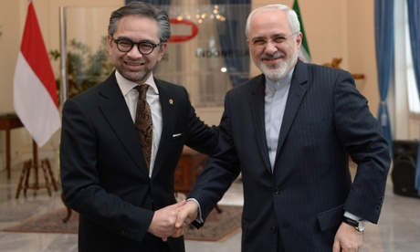 Marty Natalegawa (left) shakes hands with his Iranian counterpart, Mohammad Javad Zarif.