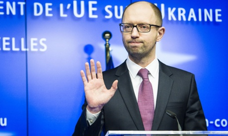 Ukraine's new prime minister Arseniy Yatsenyuk holds a press conference in Brussels.