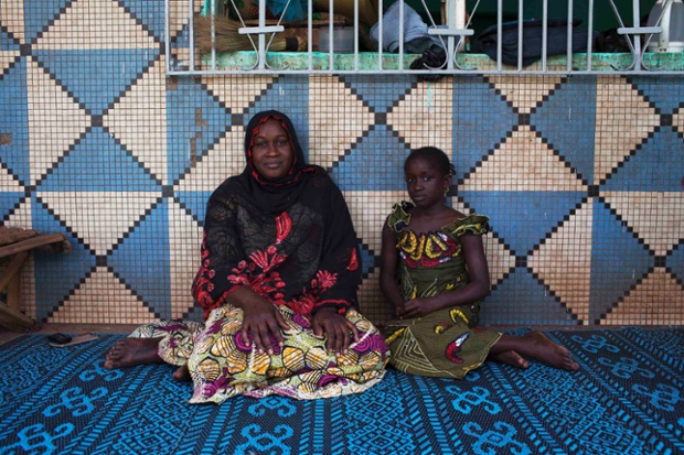 Oumou Ndiaye, 30, and her daughter Aissata Golfa, 9, pose for a picture in their house in Bamako, Mali. Oumou, who is a housewife, did not go to school. As a child she hoped to marry a local businessman. She hopes her daughter will marry someone from their ethnic group when she grows up, and that she will stay in education until she is 20 years old. Aissata says that she will finish school when she is 18, and hopes to be a schoolteacher when she grows up. Photograph: Joe Penney/Reuters