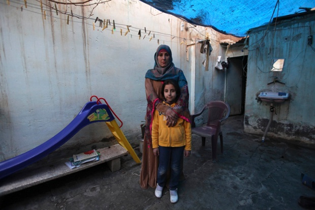 Bidaa Mhem Thabet al-Hasan (Um Suleiman), 39, poses with her daughter Mariam Khaled Masto, 9, outside their home in Deir al-Zor, Syria. Bidaa is the director of a school founded by a group of teachers and volunteers. Her ambition was to become a gynaecologist. She hopes that her daughter will join the pharmacy school, but says that she will let her follow her own ambitions and that her success will make her happy. Mariam will finish her education in 13 years, and would like to become an Arabic teacher in Deir al-Zor.