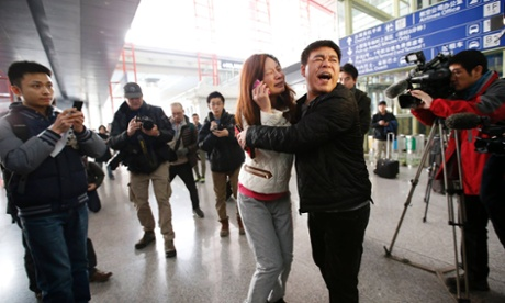Relatives of passengers at Beijing airport.
