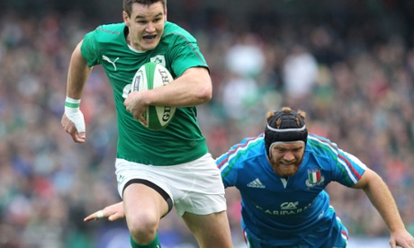 Ireland's out half Jonathan Sexton evades a tackle by Italy's centre Gonzalo Garcia to score the opening try.
