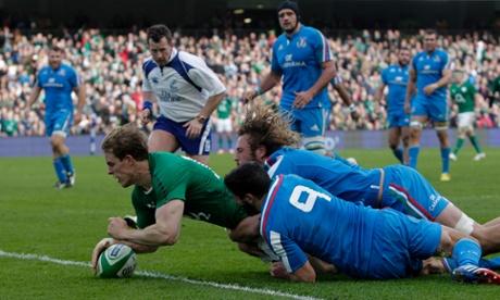 Ireland's Andrew Trimble scores his side's second try despite the attentions of Italy's Tito Tebaldi and Joshua Furno.